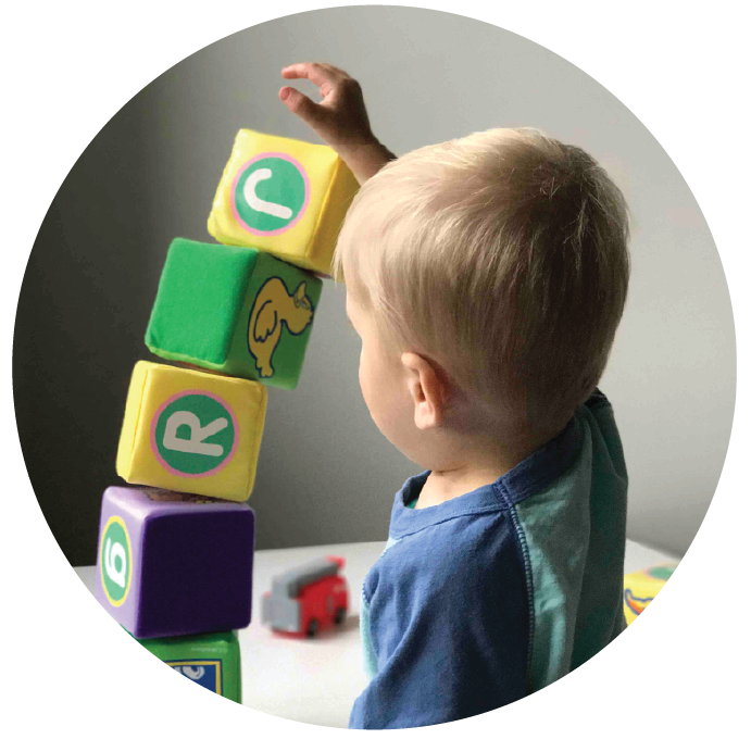 Pre-school child playing with blocks